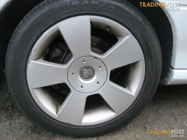VZ COMMODORE SV6 MAG WHEELS (set of 4)