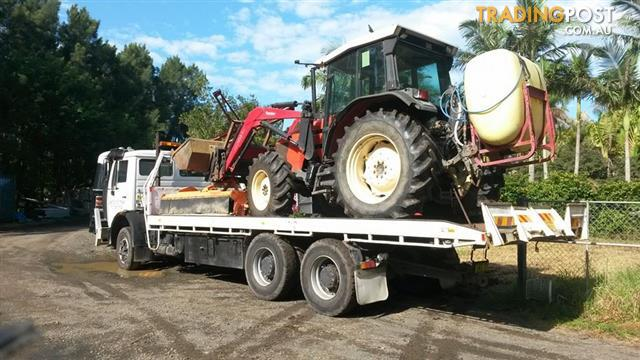 Tilt tray move shipping container site shed tractor for Tow motor operator job description
