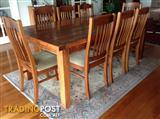 Dining table, eight upholstered chairs and sideboard