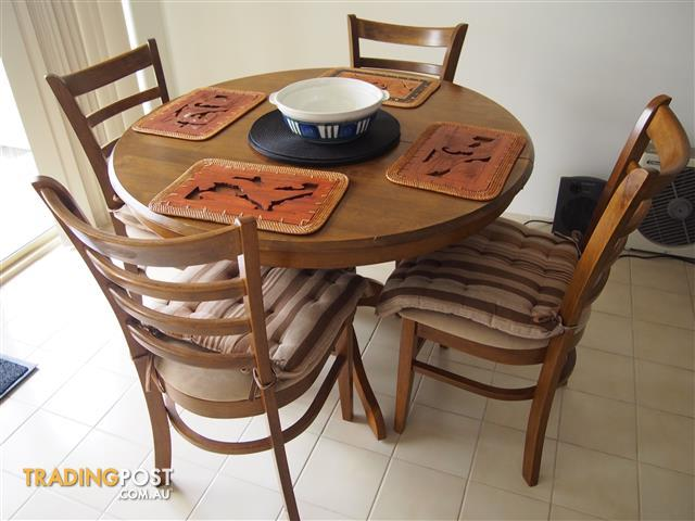 Benowa Teak 4 foot round extendable dining table with 6 matching chairs