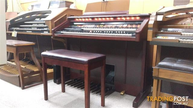 Roland Atelier Organ AT80 ~ Now Sold ~ Finished in a rich mahogany elegant cabinet