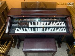 Roland Atelier Organ AT80 Finished in a rich mahogany elegant cabinet