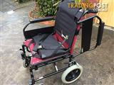 WHEELCHAIR IN GREAT CONDITION WITH SEATBEALT & ARM LIFTS