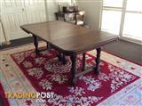 An antique French oak dining table, late 19th century
