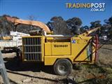 Volvo Tipper truck & tree lopping equipment. Vermeer BC1800XL Wood chipper and EWP