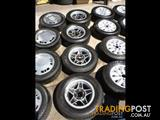 5 STARR BLACK & SILVER WHEELS & TYRES