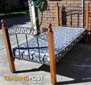 solid timber and metal frame single bed with mattress