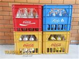 Soft drink crates with bottles and tops