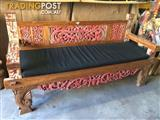 Carved Balinese daybed with cushion