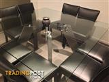 Beautiful glass dining table with 8 leather chairs