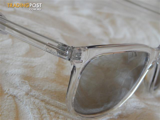 Calvin Klein mens sunglasses, silver tinted, brand new in box