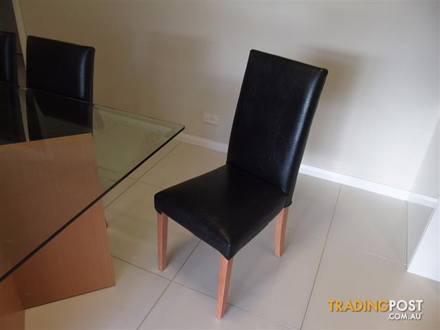 Glass top table and chairs .