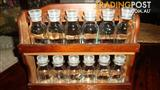 wooden spice rack with spice jars