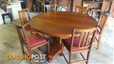 Round wooden dining room table and 6 chairs