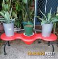 Red bench for flowers in pots
