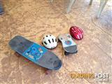 Skate boards and 2 Bycycle Helmets