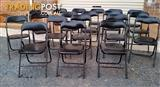 19 black fold-up chairs