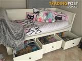 Day bed/pull out double bed with draws