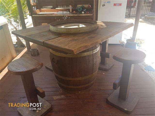 solid timber table with esky in center and 4 stools