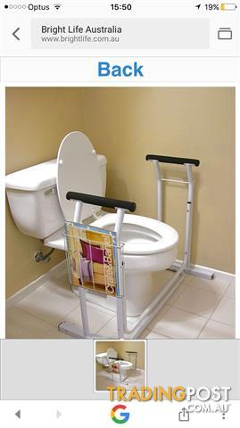 TOILET SEAT ASSISTER WITH MAGAZINE RACK