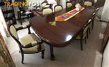 Handcrafted wooden dining table and 8 chairs.