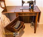 Singer Sewing machine in French Polished cabinet