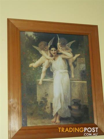 Framed print of lady with 2 angels