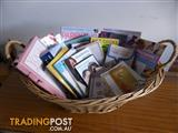 Basket of pregnancy/baby books/CDs & DVDs