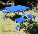 Folding table with attached seats.