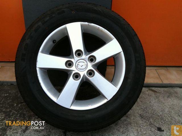mazda 3 neo 15 inch genuine alloy wheels for sale in carramar nsw mazda 3 neo 15 inch genuine. Black Bedroom Furniture Sets. Home Design Ideas