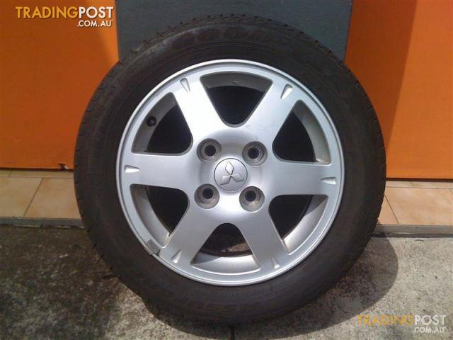 mitsubishi lancer es 15 inch genuine alloy wheels for sale. Black Bedroom Furniture Sets. Home Design Ideas