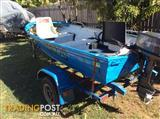 12ft Stacer with 9.8hp Tohatsu on a trailer