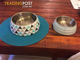 Dog food and water bowls plus drinking mat