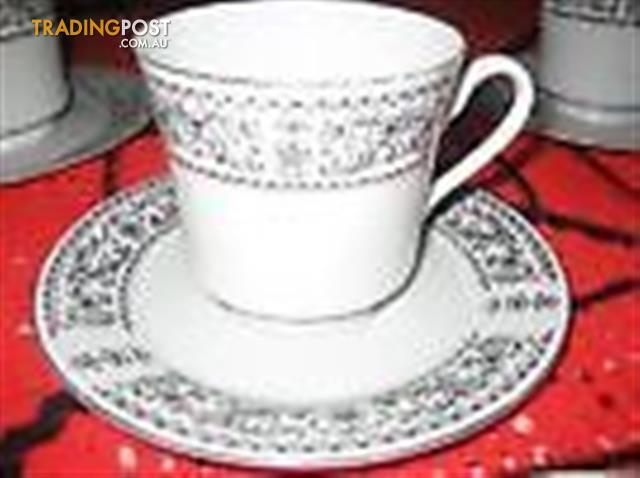 SET OF 5 TEACUPS AND MATCHING SAUCERS
