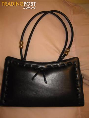 4 Leather Black Woman's Hand bags