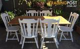 BEAUTIFUL rustic trestle dining table with 6 matching carved chairs