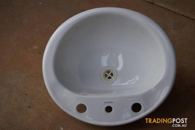 White VANITY CERAMIC BATHROOM BASIN sits over edge