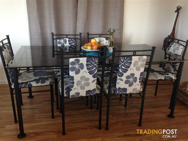 Black glass top table and 6 chairs