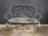 Rustic wrought iron garden bench