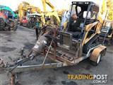 Latrobe Equipment Tandem Plant steel trailer with folding loading ramps