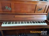 old German piano with stool ..iron frame.