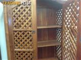 Teak lattice storage cabinet. Books, videos, drinks cabinet