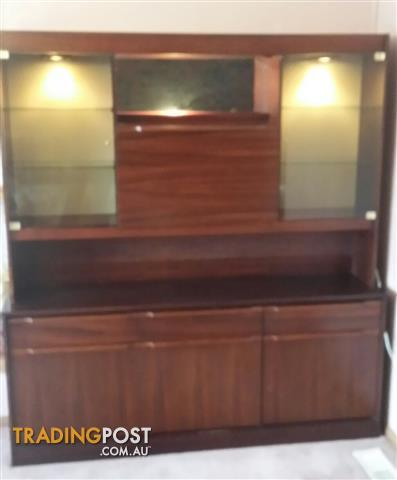 Dark wood Wall Unit with lights and bar section in very good condition.