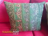 Green cushion from ISHKA